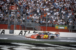 Kevin Harvick takes the checkred flag ahead of Jeff Gordon