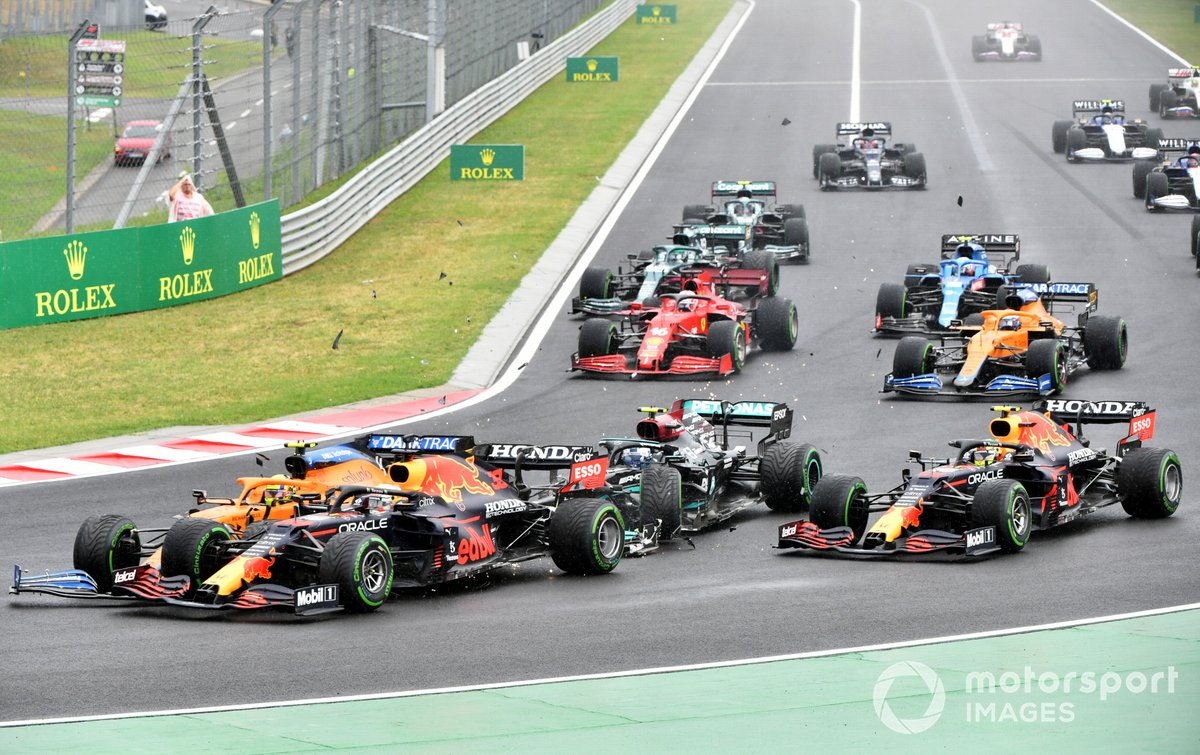 Valtteri Bottas, Mercedes W12, collides with Lando Norris, McLaren MCL35M, and Max Verstappen, Red Bull Racing RB16B, at the start