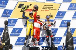 Podium: Race winner Loris Capirossi, Ducati; second place Valentino Rossi, Yamaha; third place Dani Pedrosa, Repsol Honda