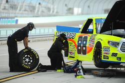 The ThorSport Racing Toyota crew works on Matt Crafton's truck