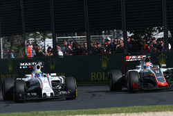Felipe Massa, Williams FW38 and Romain Grosjean, Haas F1 Team VF-16