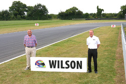 Keith Wilson and Jonathan Palmer in front of the newly renamed Wilson Corner for the late Justin Wilson