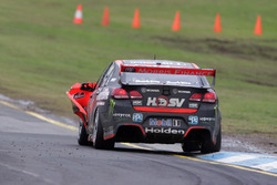 Garth Tander and Warren Luff, Holden Racing Team with a car damage