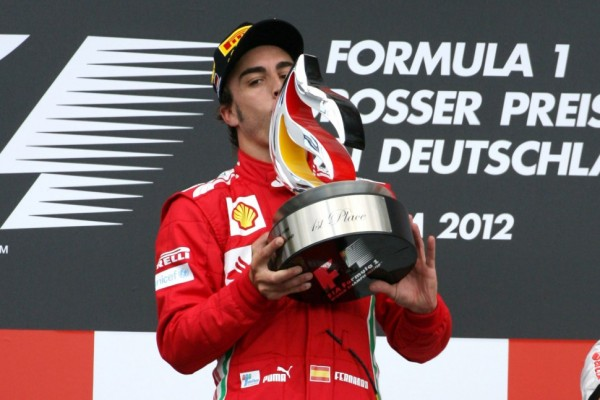 Fernando Alonso fights off Vettel's charge to win German GP