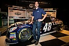 Johnson and Hendrick smiling as primary sponsor extends contract