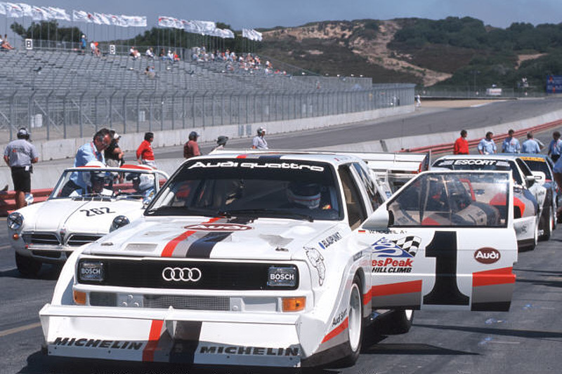 A line-up of Audis in the pits