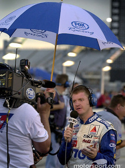 Jeff Burton conducts an interview while waiting for the rain to stop prior to qualifying