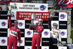 Gil de Ferran, Castroneves, and da Matta on podium
