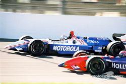 Michael Andretti and Tony Kanaan go head to head.