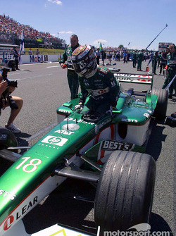 Eddie Irvine on the grid