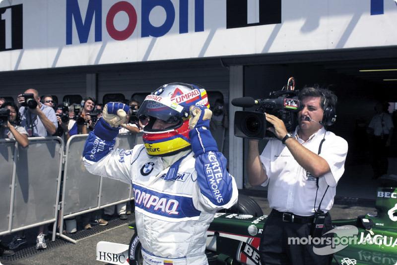 Juan Pablo Montoya celebrating his first pole position in Formula 1