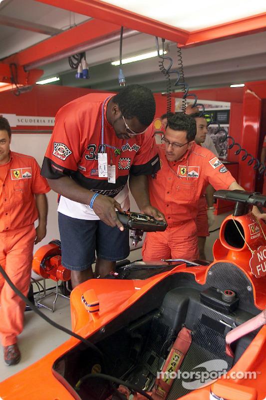 Shaquille O'Neal and Luca Baldisserri in Ferrari garage