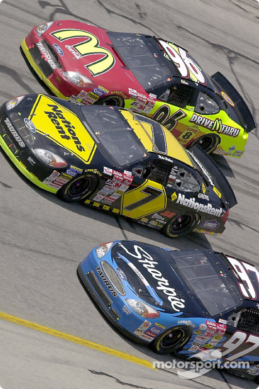 Rookie Kurt Busch races with Mike Wallace and Andy Houston through turn 4 at Talladega