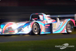 The #38 Champion Racing Porsche at speed during night practice