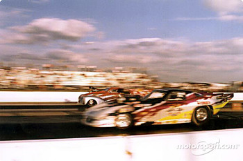 Mike Janis (near lane) won the Pro Mod final