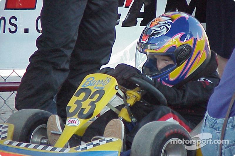 Kid kart driver Austin Seay waits on the grid.
