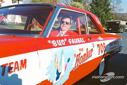 Bud Faubel sits behind the wheel of his car, the