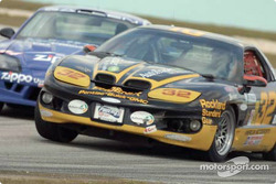 The Phoenix American Motorsports and TF Racing entries battle nose-to-nose