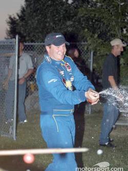 Doug Goad sprays champagne
