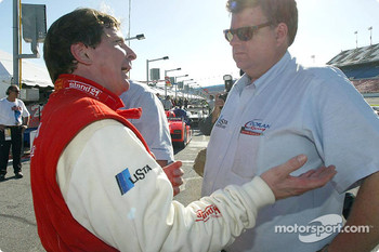 Didier Theys talks with Doran Racing team owner Kevin Doran after winning the pole position