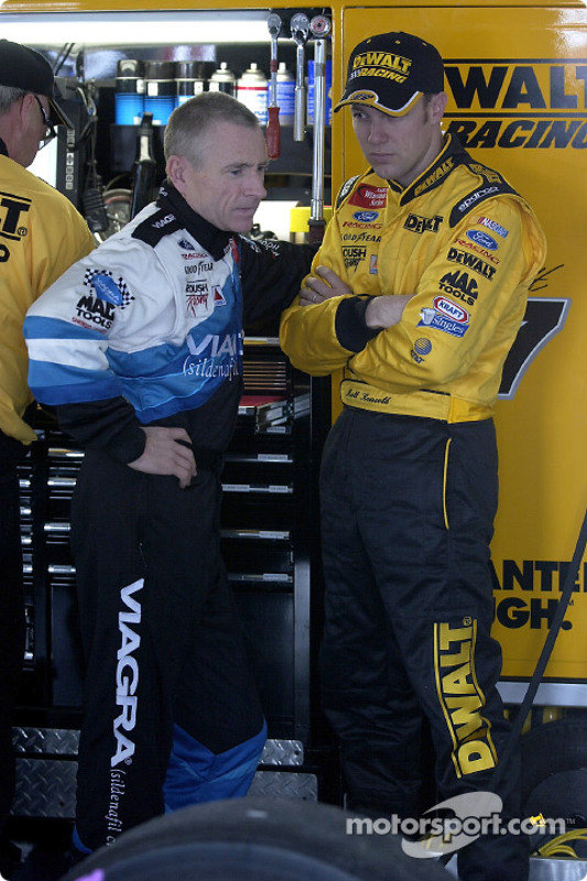 Mark Martin and teamate Matt Kenseth chat in the garage area
