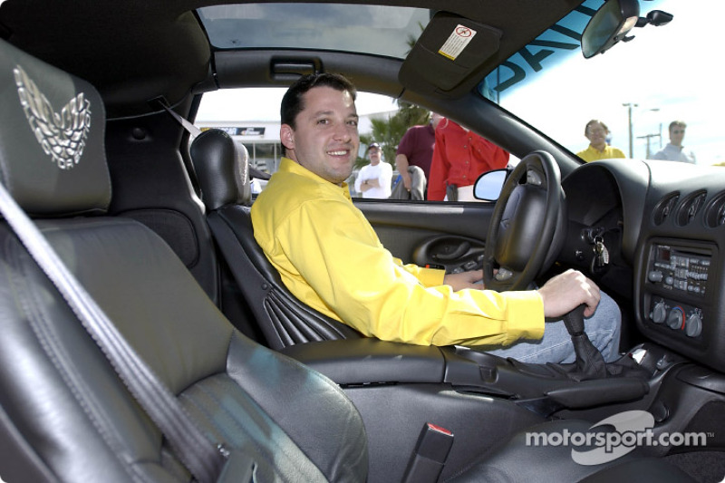 Pontiac NASCAR Winston Cup driver Tony Stewart takes the 2002 Collector Edition Trans Am pace car for a ride at Daytona International Speedway