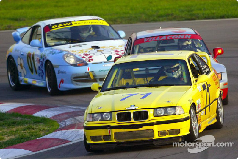 The #71 RTG Ltd. BMW M3 leads cars around a turn in California Speedway's infield