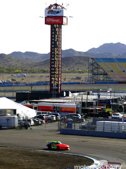 The cars work through the infield portion of Phoenix International Raceway's 1.51-mile road course during Thursday's practice sessions