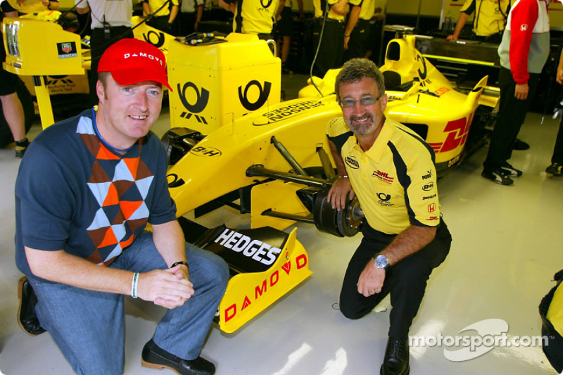 Eddie Jordan with a Damovo representative