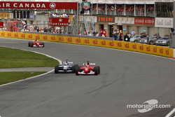 Rubens Barrichello passing Juan Pablo Montoya