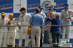 The LM GT podium: winners Timo Bernhard, Kevin Buckler and Lucas Luhr