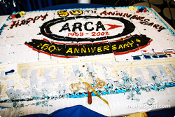 ARCA: Happy 50th Anniversary: homemade cake brought surprises to the ARCA garage area