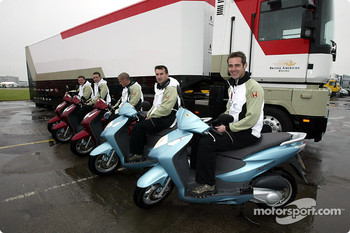 BAR crew members on their Honda scooters