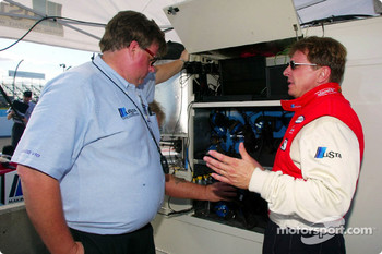 Polesitter Didier Theys discusses is qualifying run with team owner Kevin Doran after qualifying