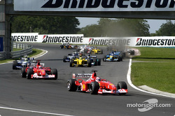 Second corner: Rubens Barrichello leading Michael Schumacher