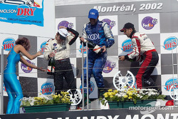 The podium: champagne for Cristiano da Matta, Dario Franchitti and Tony Kanaan