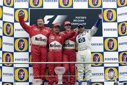 The podium: race winner Michael Schumacher with Ross Brawn, Rubens Barrichello and Juan Pablo Montoya