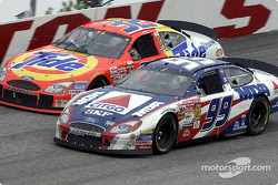 Jeff Burton passing Ricky Craven for the lead in turn 2