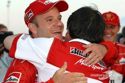 Rubens Barrichello celebrates with a Bridgestone team member