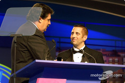 Greg Biffle receives his champions ring from NASCAR's Mike Helton