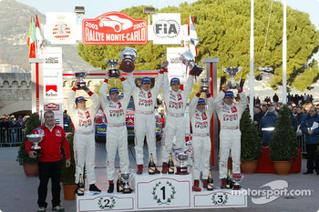 The podium: rally winners Sbastien Loeb and Daniel Elena with Carlos Sainz, Marc Marti, Colin McRae and Derek Ringer