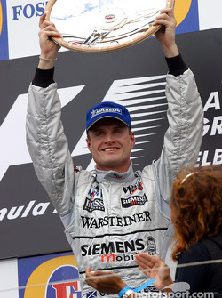 The podium: race winner David Coulthard