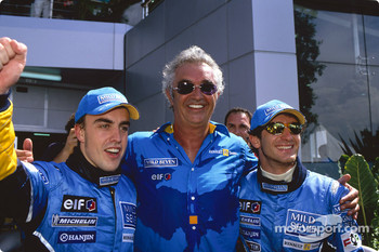 Fernando Alonso, Falvio Briatore and Jarno Trulli celebrate first row