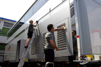McLaren team members clean up the hospitality area