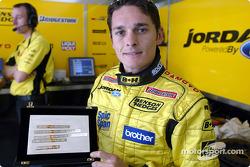 Giancarlo Fisichella with a special plaque to commemorate his first Brazilian GP win