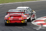 Tim Leahey (55) chasing Marcus Marshall (31) during Carrera Cup support race
