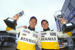 Race winner Heikki Kovalainen and Fabio Carbone