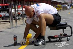 Toyota team member prepares pit area