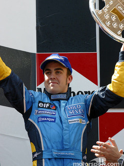 The podium: Fernando Alonso