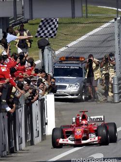 Michael Schumacher takes the checkered flag